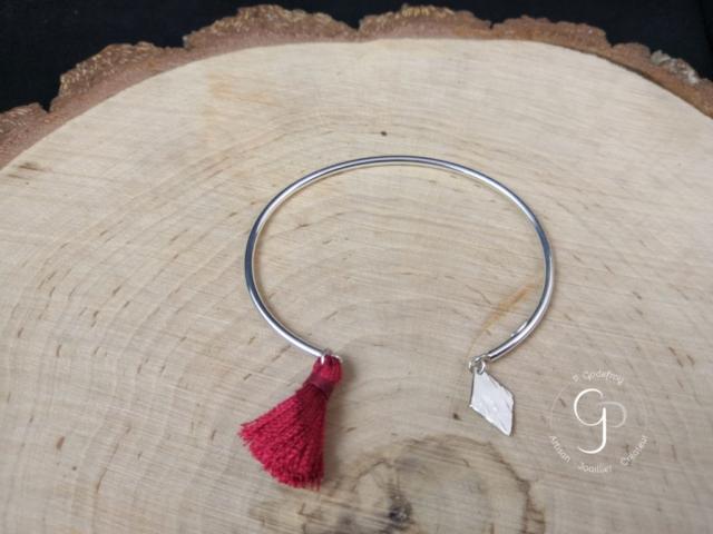 Bracelet jonc argent 925 millièmes et pompon rouge 58 euros